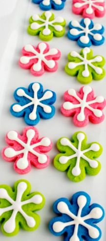 Colorful Snowflake Cookies  turn a #flower cookie cutter into a snowflake