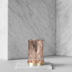 Bask in a beautiful glow with the Celestial candle holder from Skultuna. Inspired by the the motions of the planets around the sun, the intricate lines are cut from brass and finished in a lustrous co