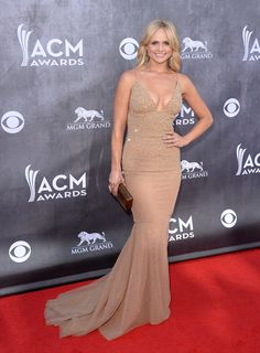 Miranda Lambert's nude, curve-conscious gown was the sexiest of the night.