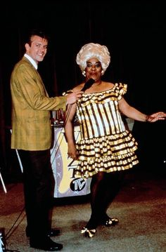 Shawn Thompson (as Corny Collins) and Ruth Brown (as Motormouth Maybelle) on the set of John Waters' Hairspray