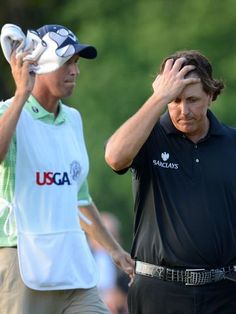 Phil Mickelson (right) and caddie Jim Mackay (left) react after coming up two shots shy of winning the 113th U.S. Open on Sunday at Merion Golf Club outside Philadelphia.