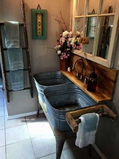 Ultimate rustic bathroom with ladder towel rack reclaimed window mirrow and washbin sinks.