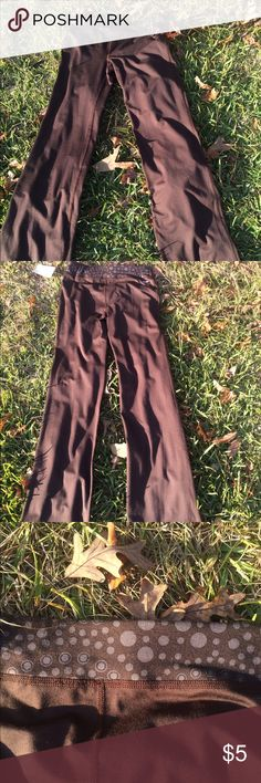 Brown yoga pants These are brown yoga pants with a polka dotted pattern on the waist band. It is a spandex and polyester material. Pants Boot Cut & Flare