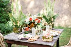 woodland bouquet: poppy pod, ferns, ivy, mushrooms, pepperberries, roses   napkin with pink tassles