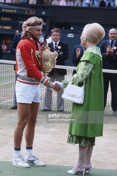 Swedish tennis player Bjorn Borg pictured shaking hands with Katharine, Duchess of Kent after defeating Roscoe Tanner to win the final of the Men's Singles tournament, 6-7, 6-1, 3-6, 6-3, 6-4 at the Wimbledon Lawn Tennis Championships at the All England Lawn Tennis Club in Wimbledon, London on 7th July 1979.