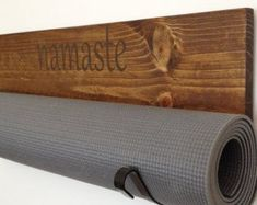 Personalized Yoga mat holders are a perfect addition to your quiet space. The wood is cut, sanded, prestained, stained and then sealed, creating a very - Yoga Slim Burn Sala Yoga, Fitness Workouts, Yoga Fitness, Deco Cool, Zen Space, Basement Gym, Zen Room, Home Yoga Room, Ideas Hogar