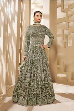 Make the heads turn whenever you dress up with this green net floor length anarkali suit. The ethnic embroidered, lace and Resham work in the attire adds a sign of attractiveness statement for your look. Floor Length Anarkali, Long Anarkali, Anarkali Dress, Anarkali Suits, Lehenga Choli, Indian Bridal Wear, Indian Ethnic Wear, Buy Salwar Kameez Online, Sari