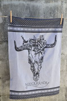 An extra large damask cloth produced on a special Jacquard loom whereby the skull design is woven into the fabric.  Manufactured in South Africa on a Jacquard loom Made from 100% cotton Size: 65cm x 85cm Designed by and exclusive to Masquerade