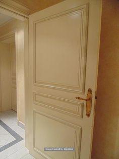 Lot 1242 - A white elegant solid core internal panel door 820mm x 2000mm