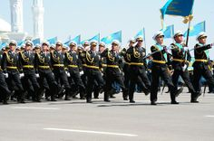 Kazakh naval officers marching down Astana's Independence Square in the 2014 Kazakhstan Armed Forces Day Parade.