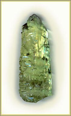 Beryl.Кристаллы берилла 4 и 2 см. с формами природного растворения на призме(1) и пинакоиде(2). Волынь, Украина.