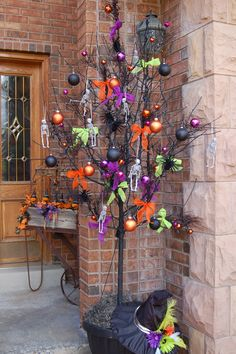 A dead tree spray painted black and made into a halloween tree.