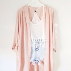 gorgeous pale pink kimono over top a bohemian lace white top and light wash jean high waisted shorts