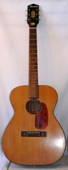 The Beast.  My first guitar.  Probably 10 of my friends have learned on this guitar.  Each of them has carved their initials into the back of it.
