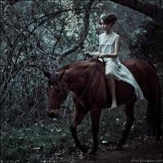 A girl riding her horse