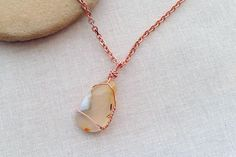 Wrap wire around a polished rock, shell or found item to make jewelry