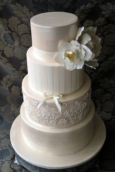 Four tier wedding cake i made for my niece...  original idea is stunning cake made by  Faye Cahill :)  Cake is covered in ivory color sugarpaste, dusted with snow flake dust, size of cake 12, 10, 8 and 6. :)