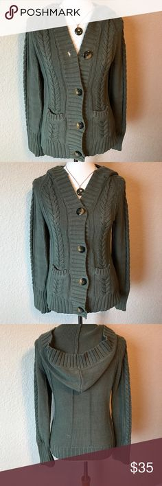 Eddie Bauer olive Cable-knit Cardigan Eddie Bauer Cable-knit hooded cardigan. Full length sleeves. Olive green color with big tortoise colored buttons. Front pockets. Great with leggings and riding boots. Or as a layering piece for enjoying the outdoors. Or sitting by the fire with a glass of wine and a good book! Eddie Bauer Sweaters Cardigans