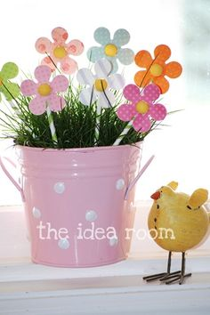 spring paper flowers with real grass in a tin bucket...very cute and easy idea