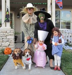 Family disguised as Wizard of Oz characters for Halloween.  See more fun Halloween costumes and party ideas at one-stop-party-ideas.com
