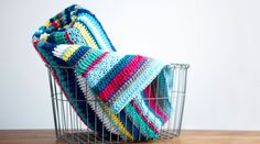 Crochet a Southwestern Throw.. the how to video is not free.. but the written pattern is free here:http://www.redheart.com/free-patterns/southwestern-rainbow-throw