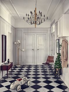 Wow. What an entrance way! Add some glamour to your space with the Flos 2097 Chandelier http://www.nest.co.uk/browse/brand/flos/flos-2097-chandelier Discover more from this home on the My Scandinavian Home blog.
