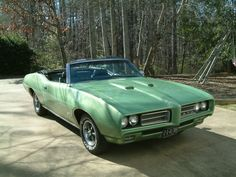 It's my dream car. 1969 GTO coupe convertible in Limelight green.  Heaven.