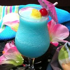 Blue Hawaiian Cocktail 1 oz rum, 1 oz blue curacao, 2 oz pineapple juice, 1 oz cream of coconut, 1 cup crushed ice