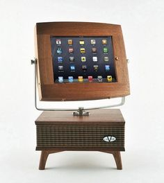 $1500 iPad stand with speaker cabinet at below designed to look like retro-tv.