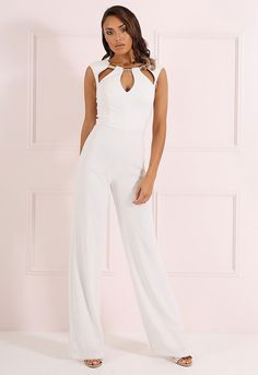 A fabulous addition to any wardrobe, the Winona jumpsuit oozes effortless sophistication with wide pant legs and a fitted design that showcases your figure perfectly. Guaranteed to make an impact, the striking cut-out detail and gold tone trim adds an edgy touch to this jumpsuit and makes this a striking option for those glam events and parties.  Cut-out detail Gold tone metal trim Fitted design Wide pant leg Rear zip fastening Also available in Navy   Team LBD recommends: Slip on a pair of…