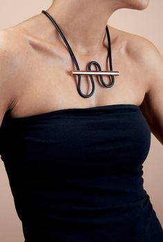 180° Necklace combines copper with leather by  Designlump from  Canada
