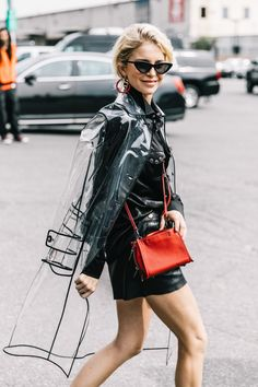 ON TREND SPRING 2018 - all things plastic. From PVC bags to coats, we love it all. Seen here - street style shot of Caroline Daur in black outfit and plastic coat . More plastic fashion inspo on the blog now! Fashion Week, Spring Fashion, Fashion Looks, Womens Fashion, Fashion Trends, High Fashion, Raincoat Outfit, Green Raincoat, Street Style