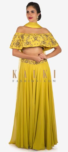 No dress can stand a chance against this fabulous number. Opt for this yellow skirt and crop top combo for the sangeet ceremony and let the onlookers. Mustard Skirt, Zardosi Embroidery, Off Shoulder Crop Top, Georgette Fabric, Mehendi, Ethnic, Carving, Ship, Number