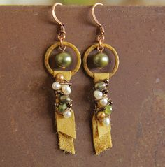 Chamois earrings, saffron patina links with leather, pearl, peridot. $18.00, via Etsy.