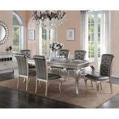 The charming and lavish style are displayed by this formal dining set trimmed in an antique silver finish. The dining table is covered in this magnificent silver hue with detailed trimmed and dainty leg Luxury Dining Room, Dining Room Sets, Dining Chair Set, Dining Room Design, Dining Room Furniture, Dining Room Table, Space Furniture, Hooker Furniture, Furniture Decor