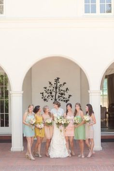 Absolutely LOVE everything about this from dusty pastel color scheme to the tiny linen (?) one-tie short cape bride is wearing.