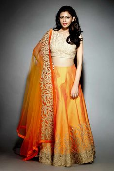 Buy mustard with hegemonic embroidery & zari work designer lehenga choli online.This set is features a off white blouse in silk fully embellished with crystal, embroidery and sequins work.It has matching mustard lehenga in jacquard silk with beautiful New Lehenga Design, Lehenga Designs, Saree Blouse Designs, Salwar Designs, Indian Gowns, Indian Attire, Indian Outfits, Western Outfits, Orange Lehenga