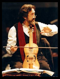 for a quick reality check, here's a contemporary picture of Jordi Savall playing a treble viol. Just note the general size, shape, and proportions of the instrument, and regardless of playing posture (he too grew up seeing mostly 17th century pictures of viols, and was raised the 20th century werein most viol revivalists thought all viols, of all sizes, were always and only played da gamba, never da braccio). This is a 6 string viol (patterned or pastiched after some late 15th or early 16th…