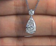 1.79ct Pear shape diamond pendant, 1.59ct E-SI2 eye clean and Excellent Brilliance, round diamond additional 0.20ct graded as F/G-VS, set in 18kt white gold with 18kt chain. (6075) Appraisal included.