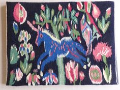 We know that this magnificent wool handwoven tapestry of a unicorn was woven in 1970, as the weaver, Berta Jansson from Halsingland, signed her name and the date on the back of the mount board. The glorious blue and pink unicorn flies across the blue/black background past wonderful stylised trees and flowers. There are lots of pinks and blue/greens in this joyous piece, and the colours are as fresh and vivid and glowing as when it was first made. It is pinned to a partially fabric covered…