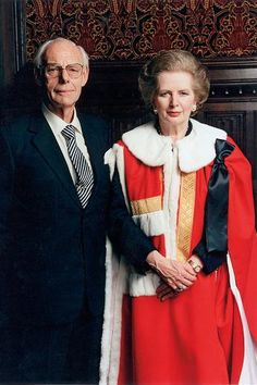 Margaret Thatcher wearing the robes of a peer of the House of Lords, with her husband Denis