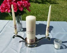 Check out this item in my Etsy shop https://www.etsy.com/listing/457669476/personalized-unity-candle-set-with-stand