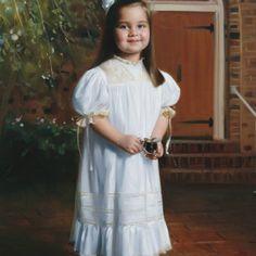 Adorable girl in her Mela Wilson Heirloom dress.For more information write at mela.wilson2@comcast.net