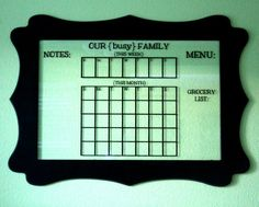 Glass dry erase calendar, a cute way for any busy family to get organized! { lilluna.com }
