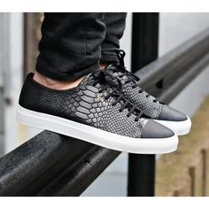 Axel Arigato black python embossed leather sneaker with a classic design, handcrafted with premium Italian materials. #axelarigato
