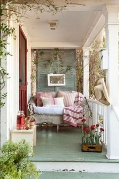 Cottage Porch with Wrap around porch, exterior stone floors, Forever Patio Wicker Naples Settee