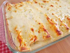 Creamy Chicken Enchiladas with white sauce is my favorite way to make enchiladas now! So good served with refried beans and rice!