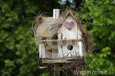 Birdhouse garden retreat with a forest background in nature