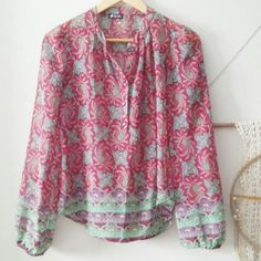 Boho Flowy Sheer Top This is a polyester boho style top with beautiful colors and 4 buttons. There is a very very small stitch issue on shoulder but not noticeable and an easy fix. The size is not labeled but is fits like a small to medium.  It is a Lily White brand. Lily White Tops