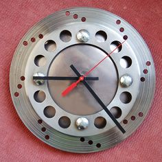 "Need a gift idea for a ""man cave""? Artist and motorcycle safety instructor Michole Madden in Seabeck, WA, makes these clocks from recycled motorcycle parts."